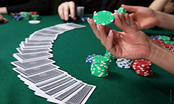 Comparing card games like Blackjack is when the player is competing against the dealer and not against other players.
