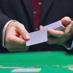 Blackjack croupier dealing cards