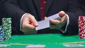 Blackjack croupier dealing cards